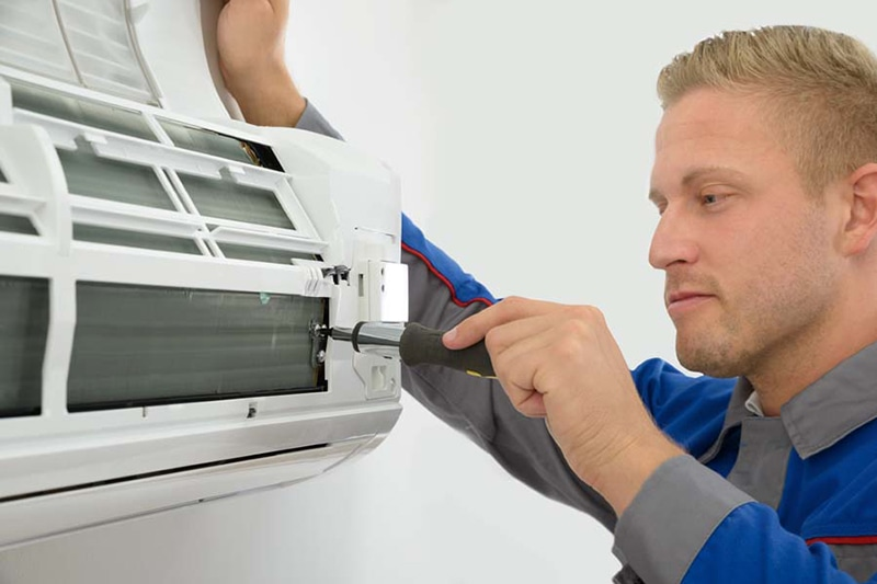 Technician Repairing Air Conditioner, Do I Really Need an AC Tune-Up? | Repair, Maintain | Olympia, WA